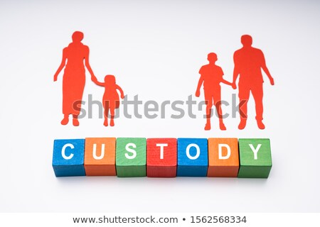 Word Custody With Paper Figures Of Family On White Background Stock photo © AndreyPopov