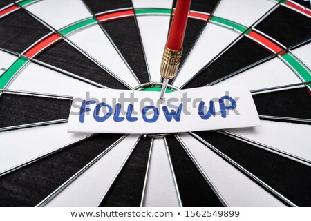 Follow Up Text At The Center Of Dartboard Stock photo © AndreyPopov