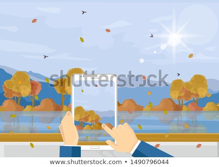 Man with smartphone taking picture of autumn landscape Vector. Fall season landscape flat styles Stock photo © frimufilms