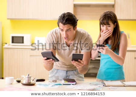The young family struggling with personal finance Stock photo © Elnur