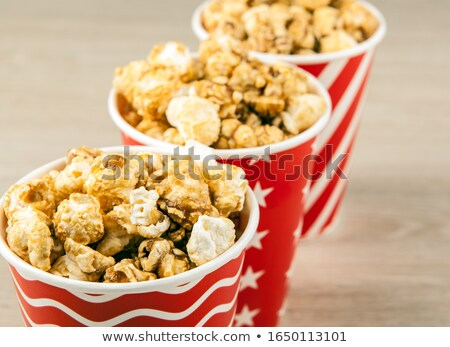 three red cardboard cup in a row with sugar popcorn Stock photo © mizar_21984