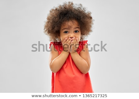 confused african american girl covering mouth Stock photo © dolgachov