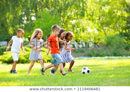 Little kids playing football Stock photo © jossdiim