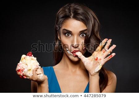 Piękna kobieta jedzenie kawałek ciasto biały kobieta Zdjęcia stock © vladacanon