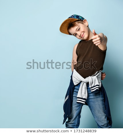 smiling boy in blue hoodie showing thumbs up Stock photo © dolgachov