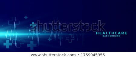 healthcare medical background with cardiograph line and plus sign Stock photo © SArts