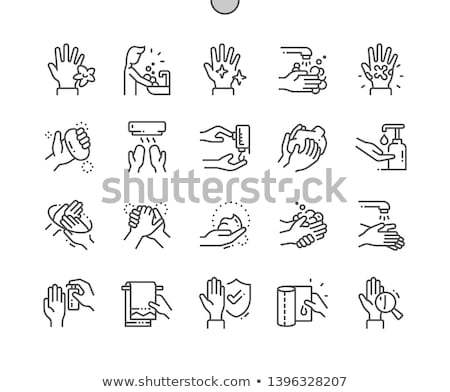 Hand washing the dishes Stock photo © rcarner