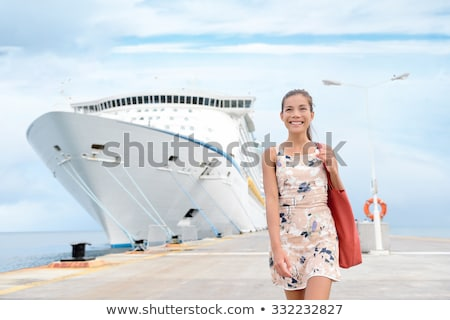 Luxury cruise ship vacation on tropical ocean travel - Young tourist woman watching sunset on deck o Stock photo © Maridav