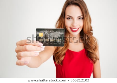 close up portrait of young female holding credit card isolated o stock photo © dacasdo