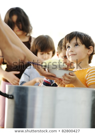 Arme kinderen armoede distributie steun voedsel Stockfoto © zurijeta