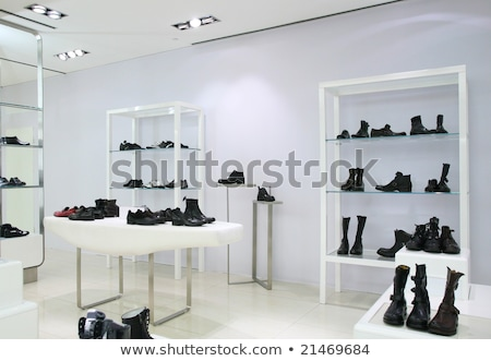 Division of store with foot-wear and belts