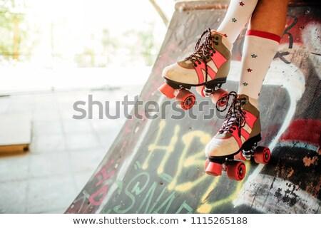 Beautiful long legged girl roller skating in park Stock photo © darrinhenry