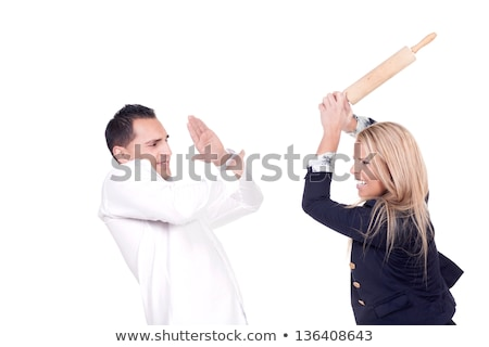 Angry woman threatening man with rolling pin Stock photo © photography33