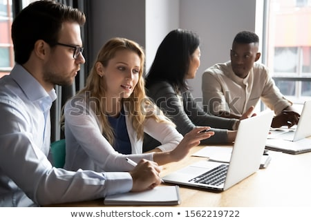 Pair of confident executives with laptop computer Stock photo © photography33
