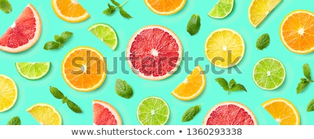 abstract green background with citrus fruit of lime slices stock photo © boroda