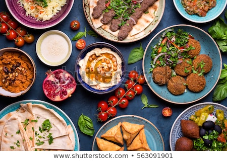 Közel-keleti étel férfi zöldségek ázsiai eszik Stock fotó © zurijeta