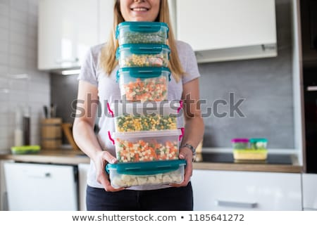 Woman holding plastic food storage Stock photo © photography33