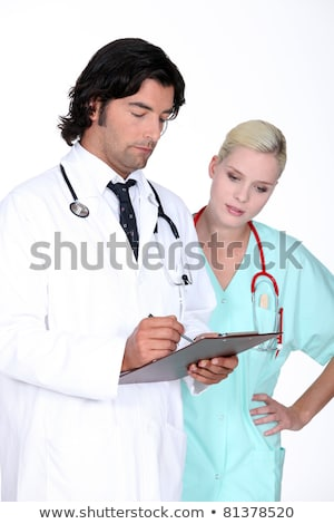 Doctor going over a patient's record with his assistant Stock photo © photography33