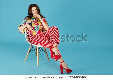 Сток-фото: женщину · ярко · одежды · сидят · Председатель