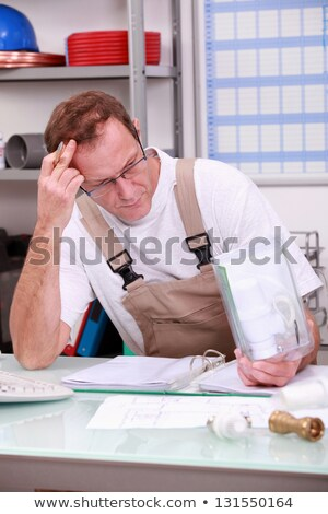 Reviewing Plumber reports Stock photo © photography33