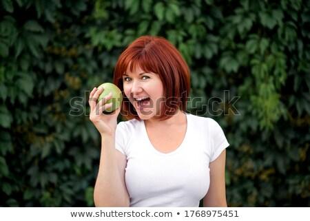 Feliz jovem pronto morder verde maçã Foto stock © get4net
