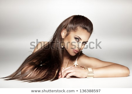 woman wearing gold earrings and bracelet Stock photo © dolgachov