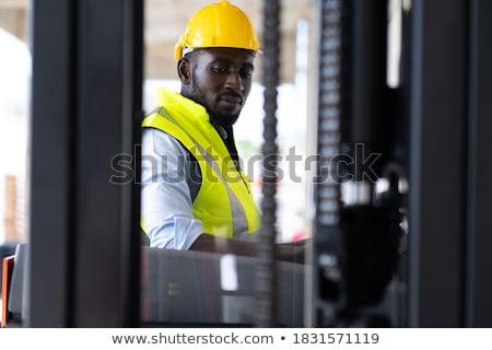 Férfi munkavédelmi sisak jóképű férfi néz kamera mosoly Stock fotó © jayfish