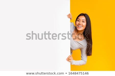 Attractive woman displaying a blank card Stock photo © stryjek