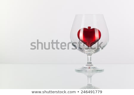 Vermelho coração dentro vidro conhaque prato Foto stock © CaptureLight