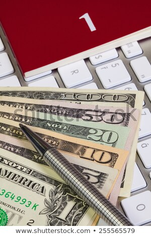 Business desk - Diary for January,US dollars,pen and keyboard Stock photo © CaptureLight