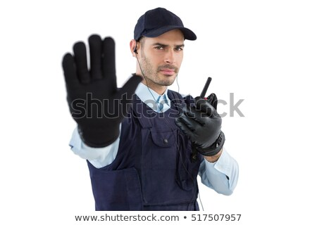 Stock photo: Confident Bodyguard Making Stop Gesture