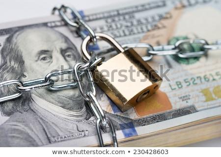 secure money padlock concept us dollars stock photo © alexmillos