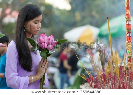 Pretty Vietnamese girl praying Stock photo © smithore