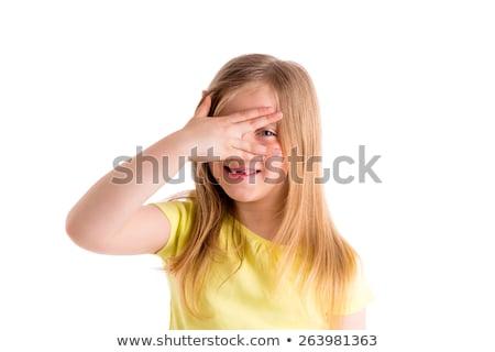 Szőke gyerek lány rejtőzködik szemek ujjak Stock fotó © lunamarina