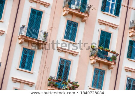 Building exterior with windows and balconies in Palermo, Italy Stock photo © ankarb