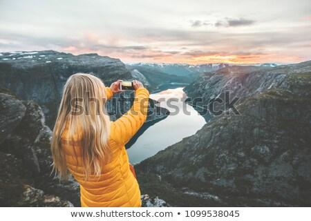Girl taking photos of sunset. Stock photo © NeonShot