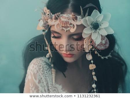 beautiful woman with seashell Stock photo © dolgachov