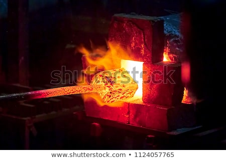 smith forging hot iron stock photo © jordanrusev
