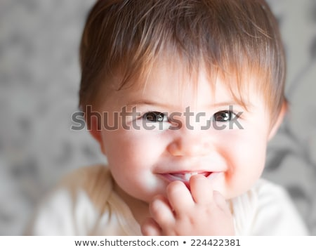 Close-up of a baby boy smiling Stock photo © imagedb