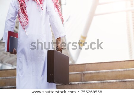 closeup picture of a businessman holding a briefcase stock photo © feedough