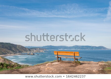 Stock photo: beautiful soft waves breaking on the cliffs