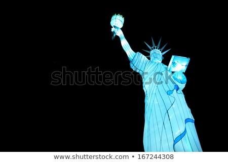 статуя свободы свечу пламени Skyline реке Сток-фото © Bigalbaloo