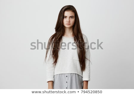 confident pensive young woman with beautiful long dark hair stock photo © deandrobot