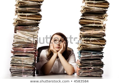 Woman with stack of files looking upwards Stock photo © Hofmeester