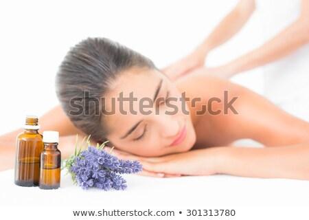 beautiful brunette on massage table stock photo © wavebreak_media