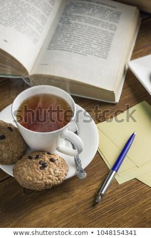 Сток-фото: Homemade Chocolate Chip Cookies Milk Cup And Book