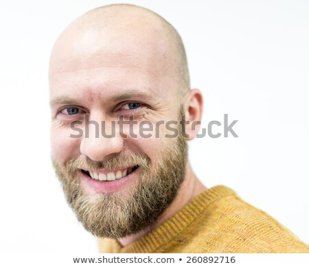 bald young handsome man with blond beard smiling stock photo © zurijeta