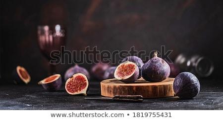 świeże figa cięcia tablicy fioletowy zdrowych Zdjęcia stock © Digifoodstock
