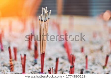 lighting joss sticks stock photo © bbbar