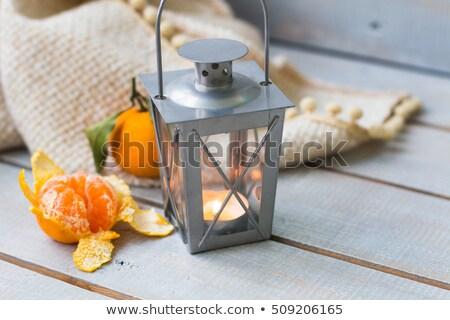 Christmas still life with lantern, plaid,  tangerine and red bea Stock photo © Yatsenko